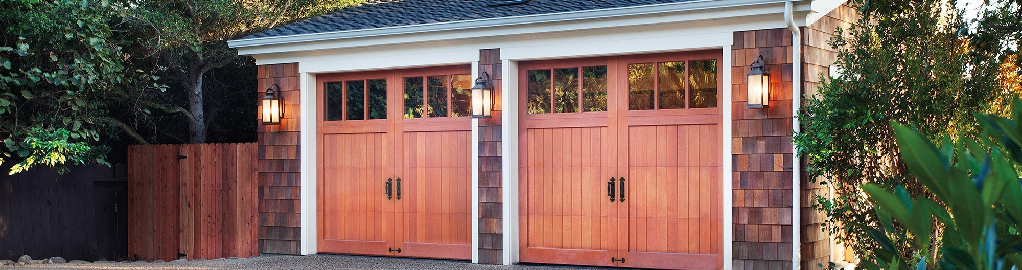 two wooden carriage garage doors